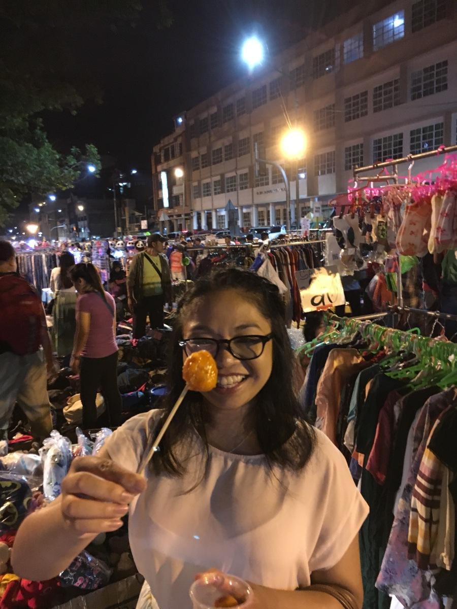 me eating kwek kwek during the night market in baguio city
